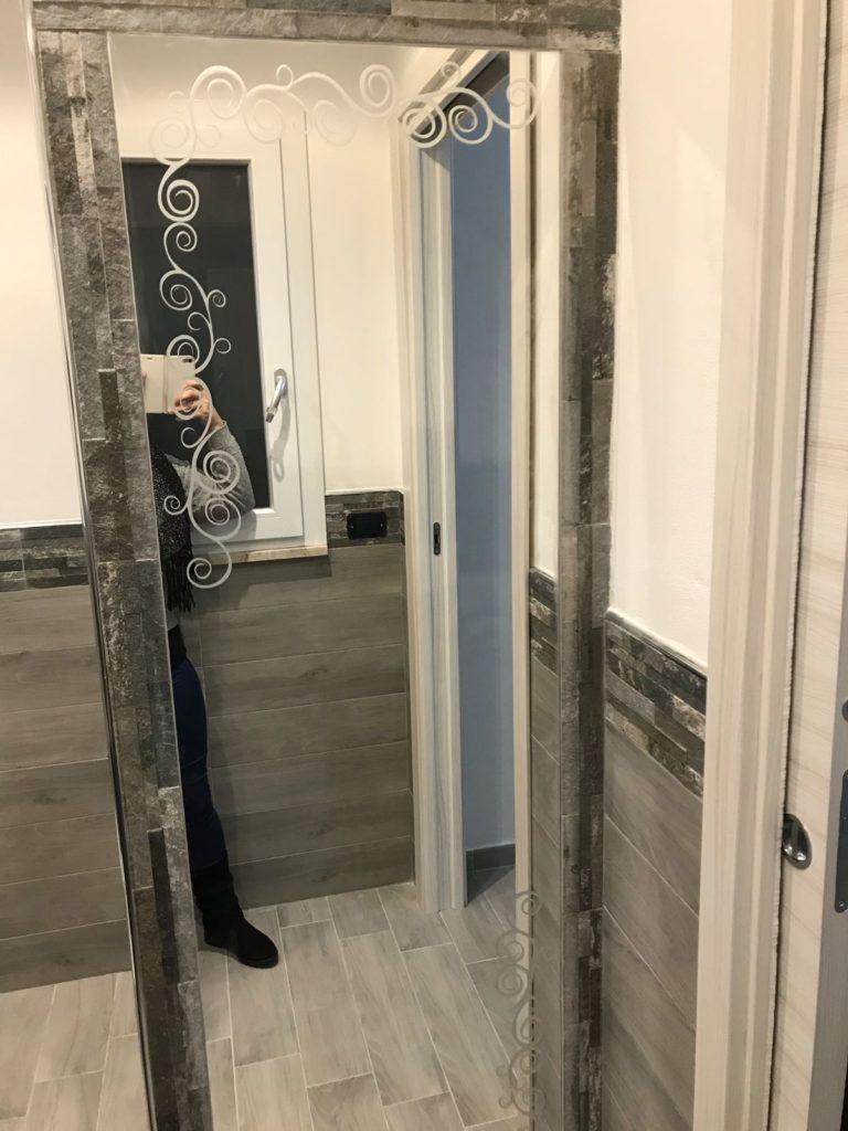 Specchio con particolari in sabbiatura